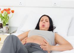 почему изжога у беременных на ранних сроках